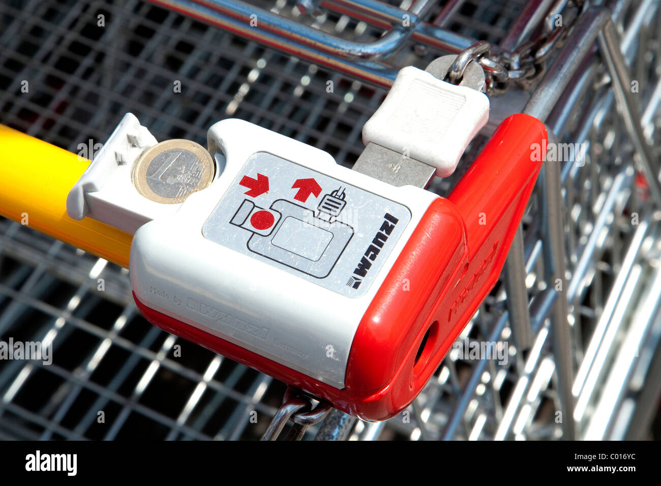 Shopping trolley with one Euro coin - Stock Image