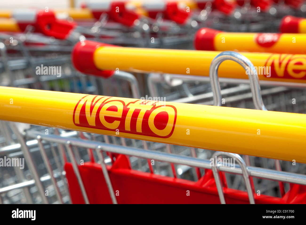 Shopping trolley of discount food store Netto, Heideck, Bavaria, Germany, Europe - Stock Image
