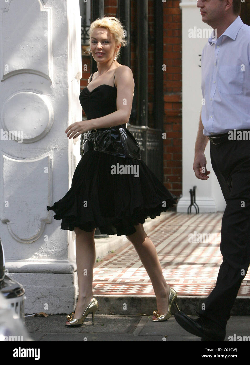 Kylie Minogue leaving her apartment this morning on her way to a recording studio. The pint sized singer has justStock Photo