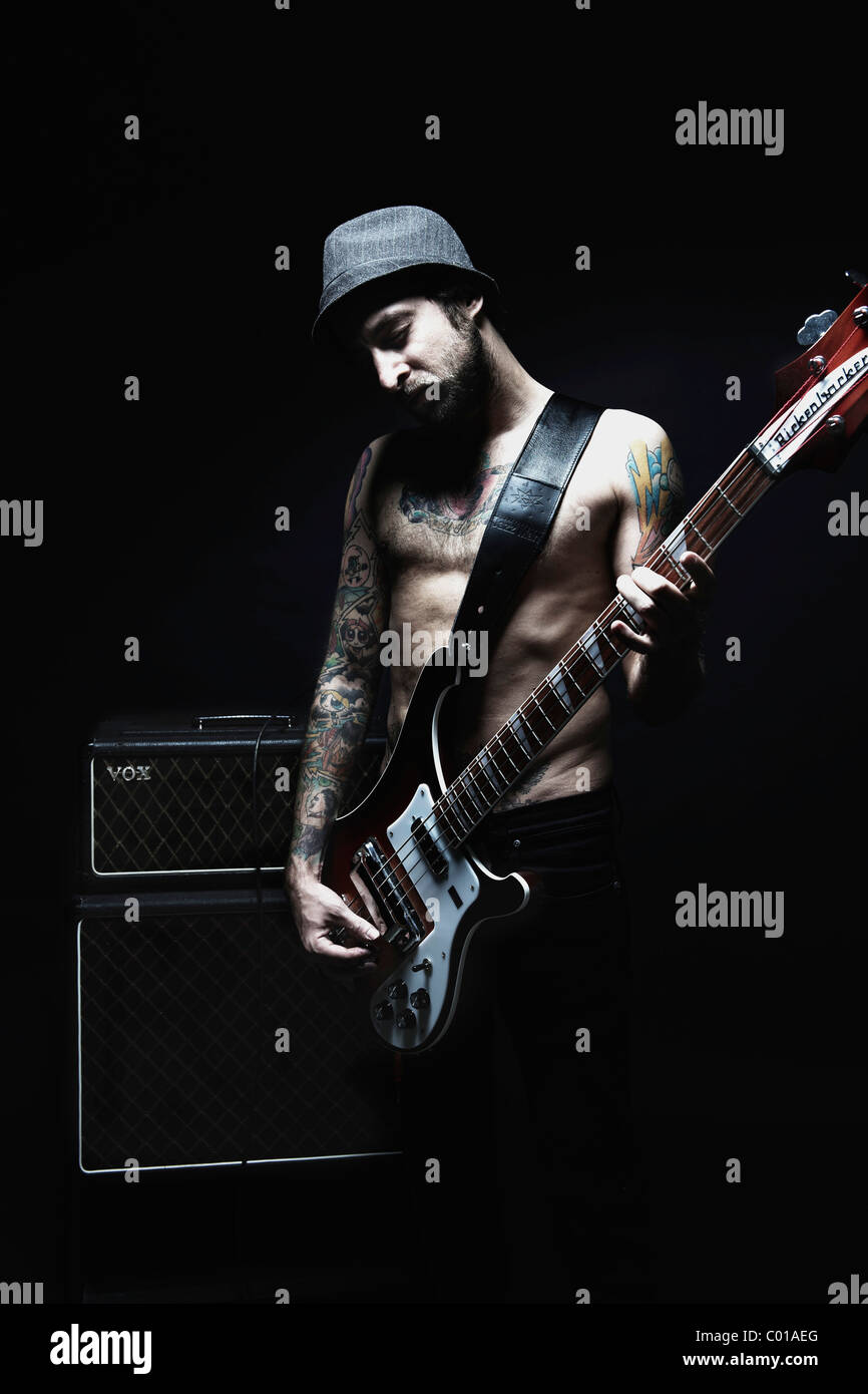 Musician Rickenbaker bass and VOX AP - Stock Image