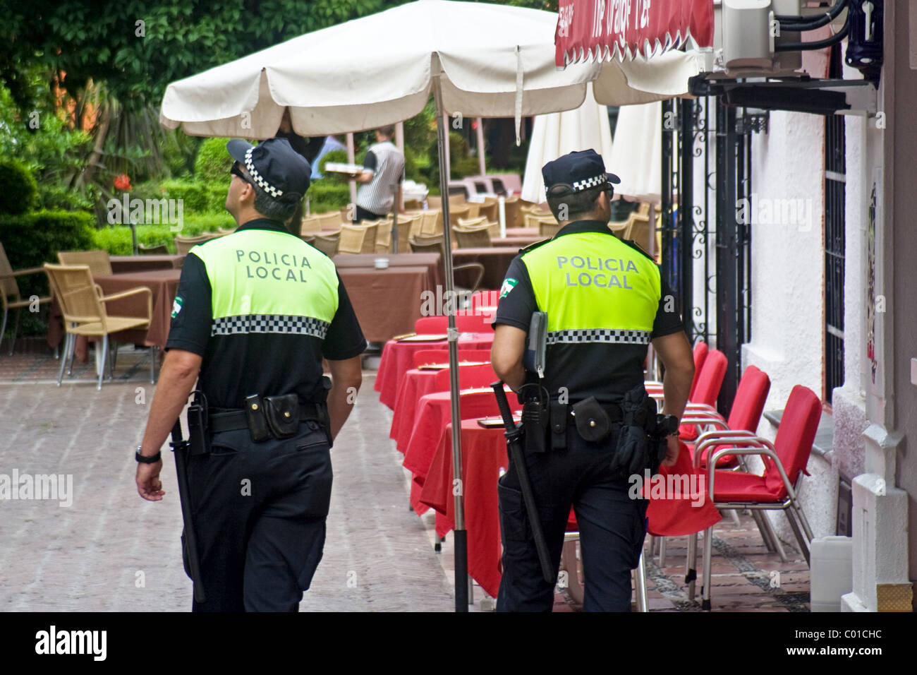 Local police patrolling in the old town, Marbella, Costa del Sol, Andalucia, Spain - Stock Image