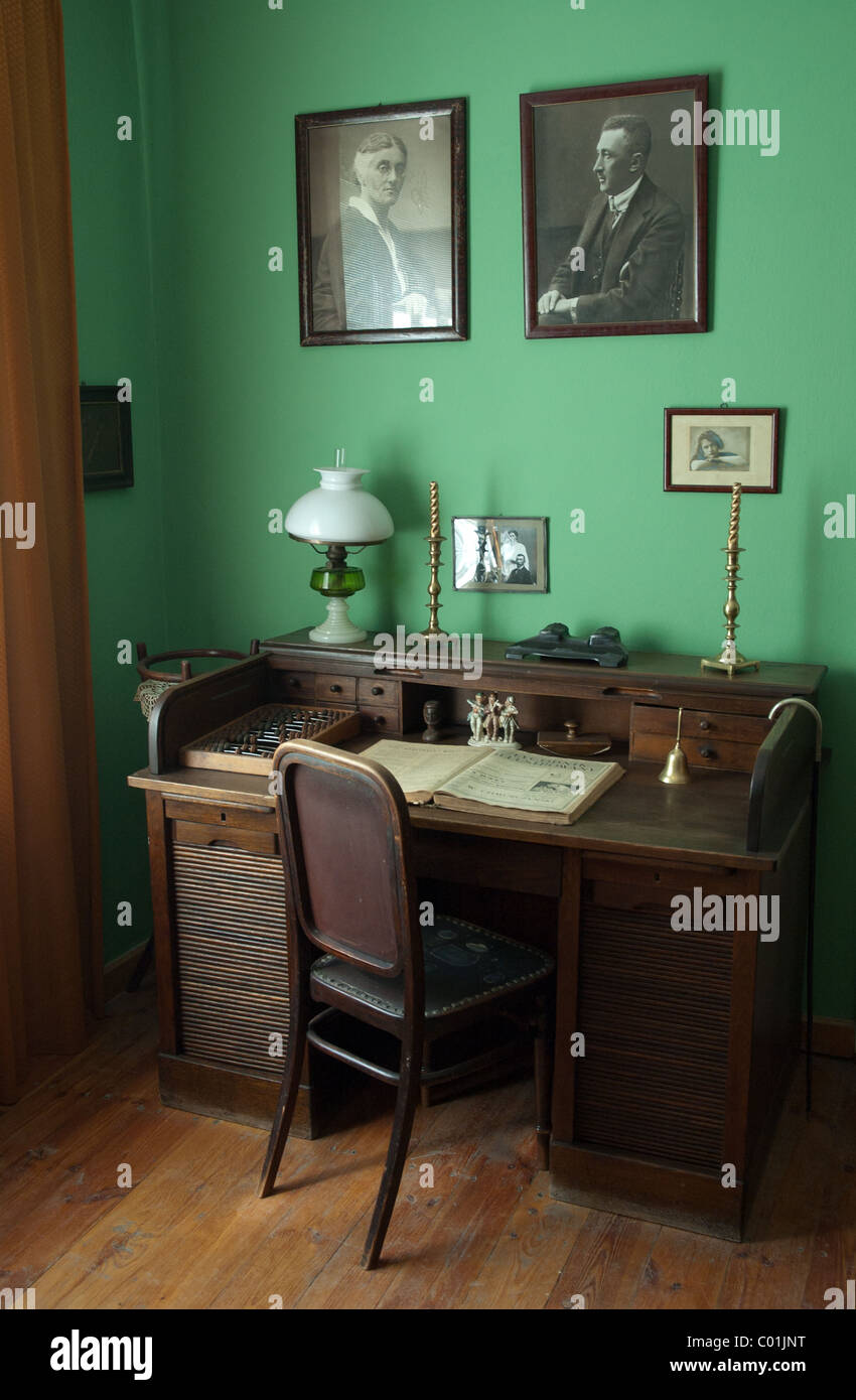 Classic desk with appliances like chair, lamp etc. Shot in manor house in Janowiec (lubelskie), Poland. Stock Photo