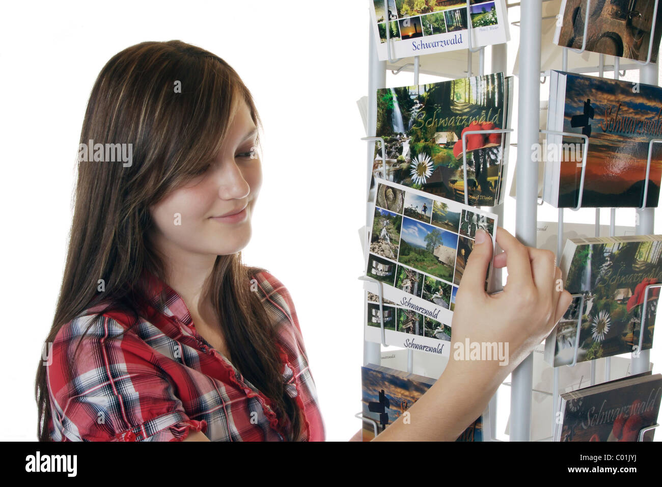 A young girl looking at postcards - Stock Image