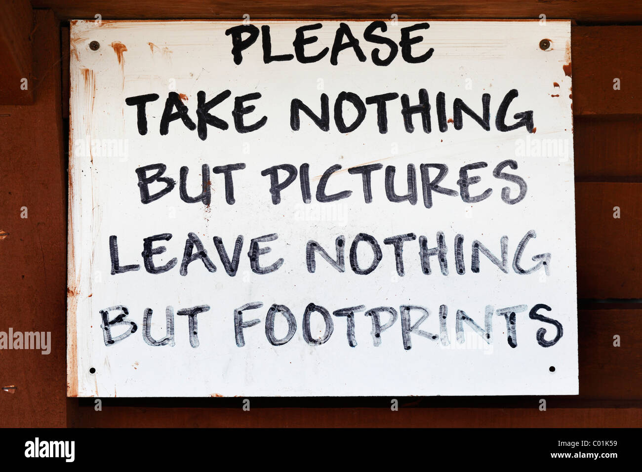 Handwritten sign 'Please take nothing but pictures, leave nothing but footprints', County Offaly, Republic - Stock Image