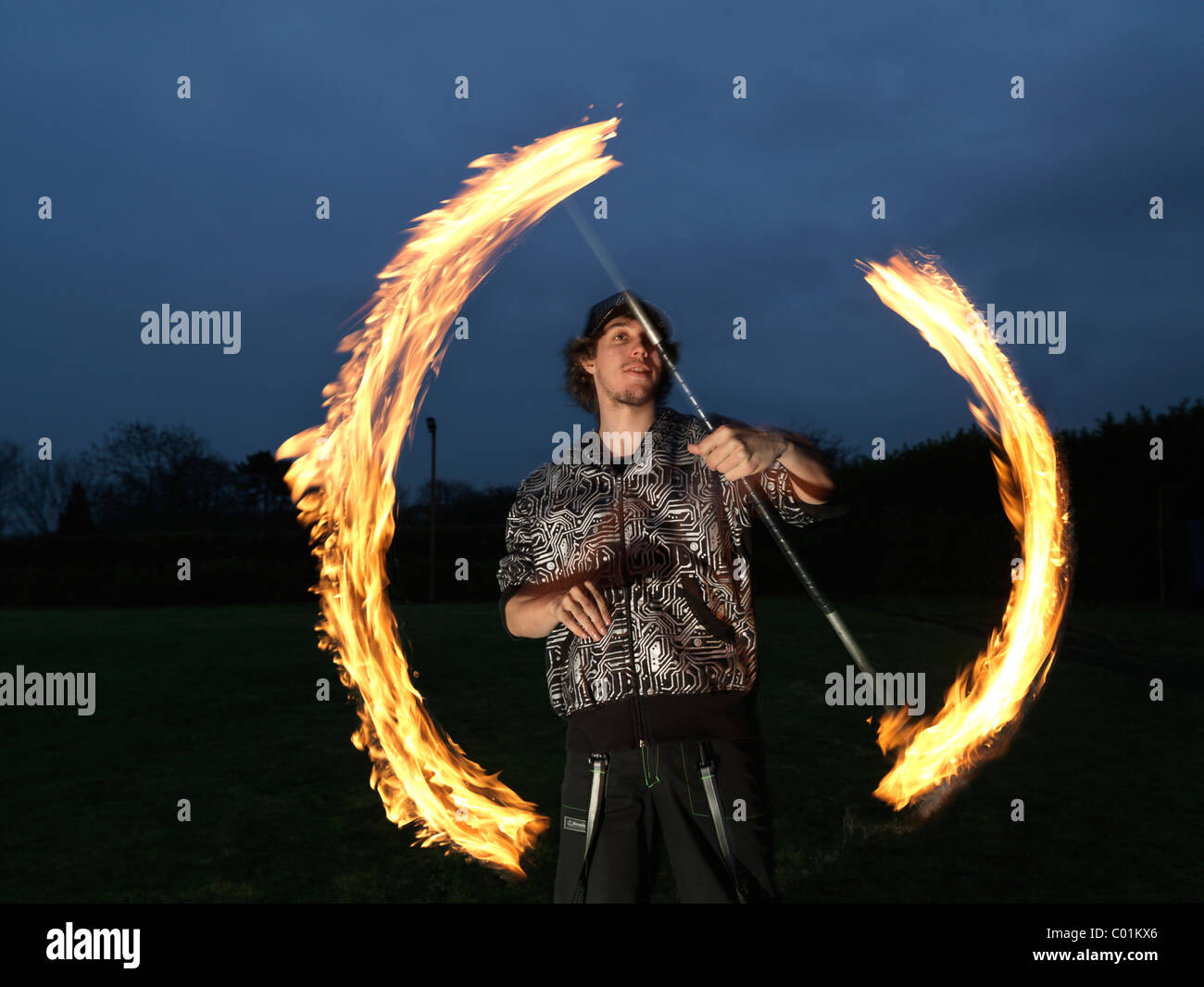 Fire eater juggling - Stock Image