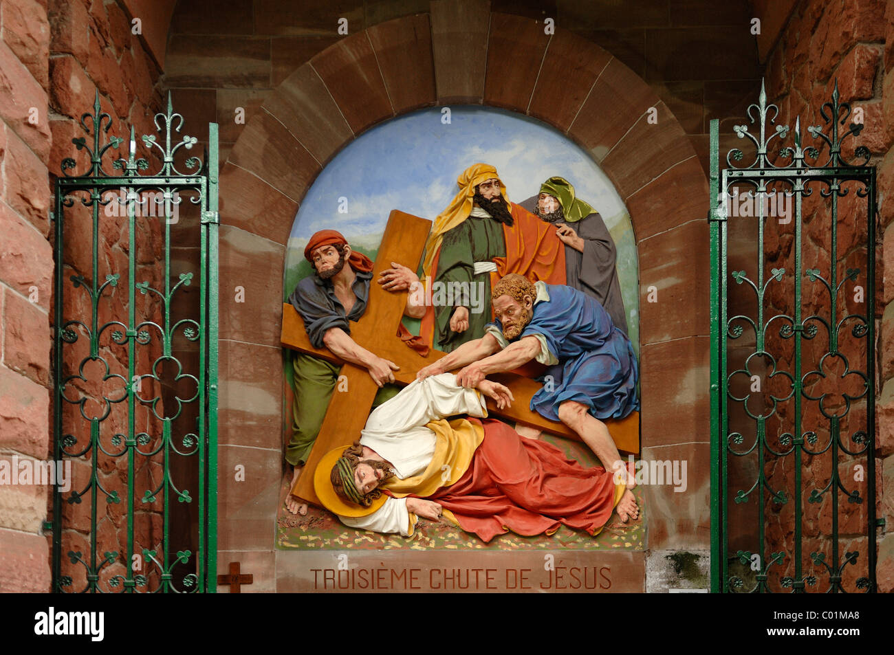 Ninth relief, Stations of the Cross to Dusenbach monastery, Jesus falling for a third time under the weight of the - Stock Image