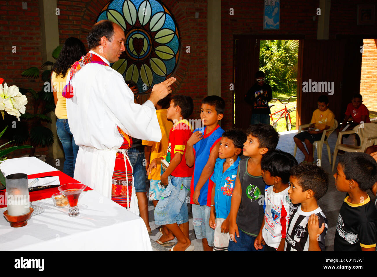 Priest blessing children, Sunday school, Fortaleza, Ceará, Brazil, South America - Stock Image