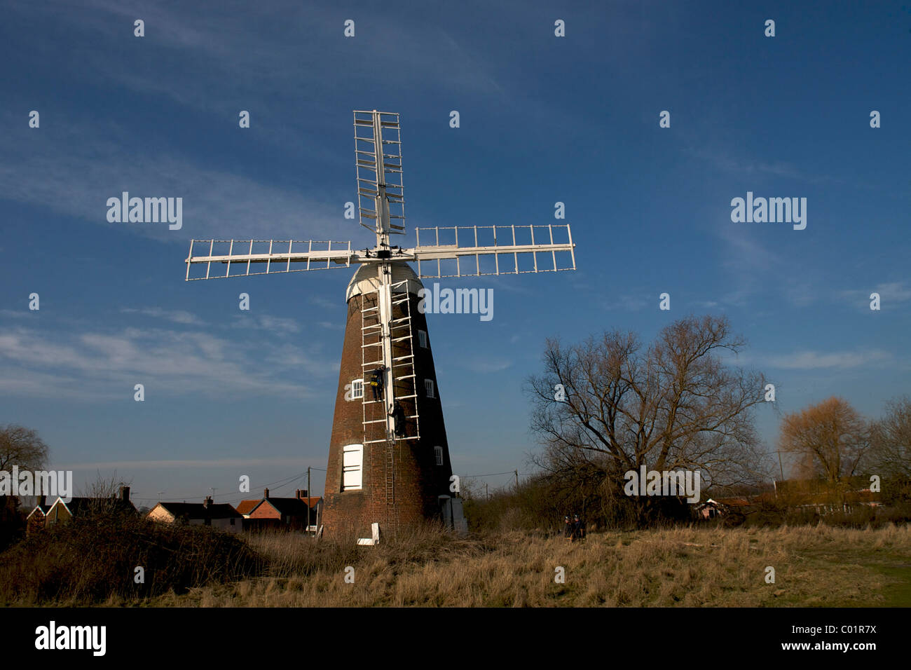 Billingford Windmill is a grade II listed tower mill near Diss, Norfolk. It is having it's sails removed before - Stock Image