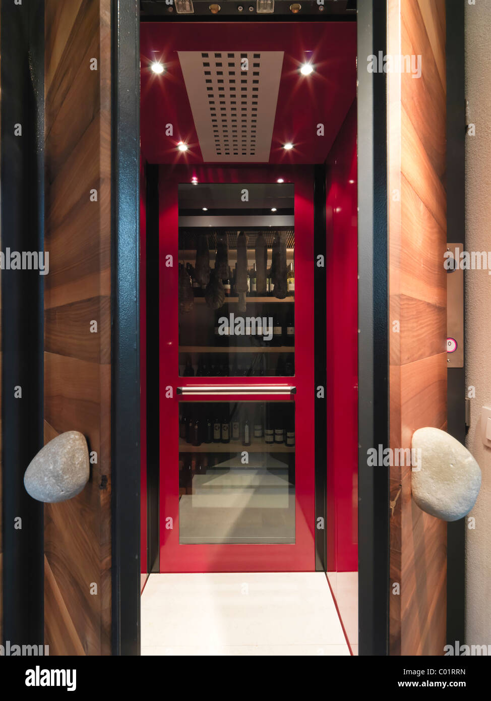 modern red elevator with glass wall overlooking the winery - Stock Image
