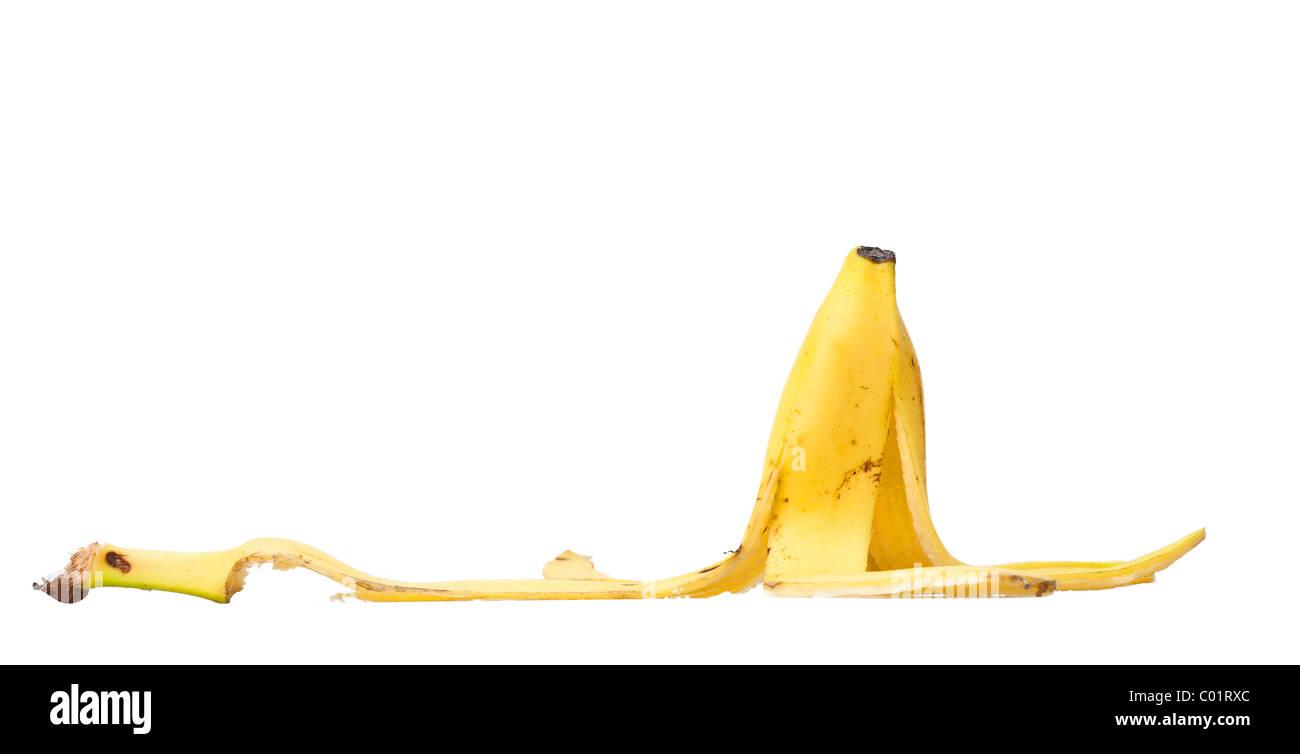 banana skin isolated against a white background - Stock Image