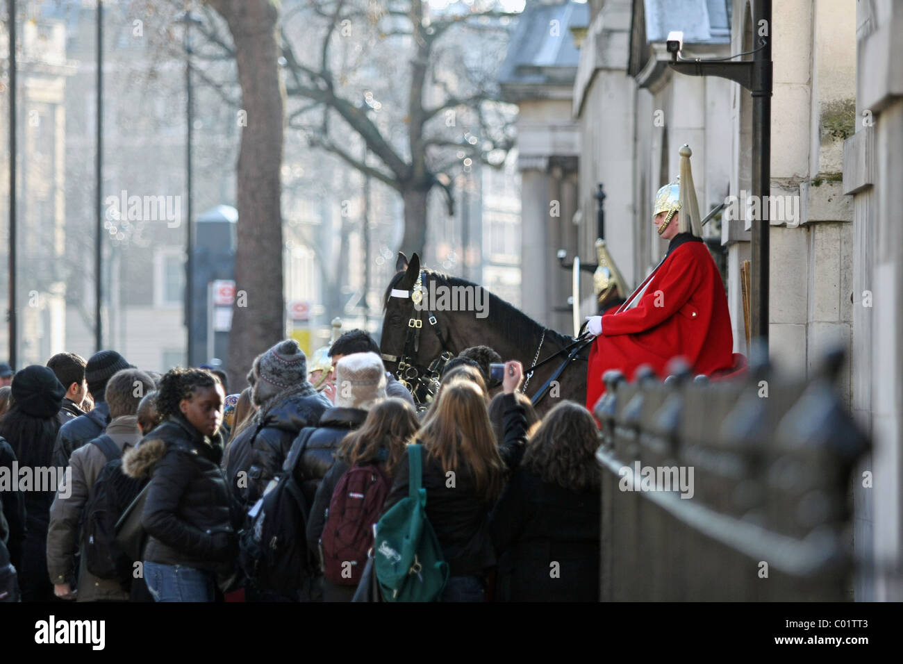 people watching the Queen's Life Guards in Whitehall, London Stock Photo