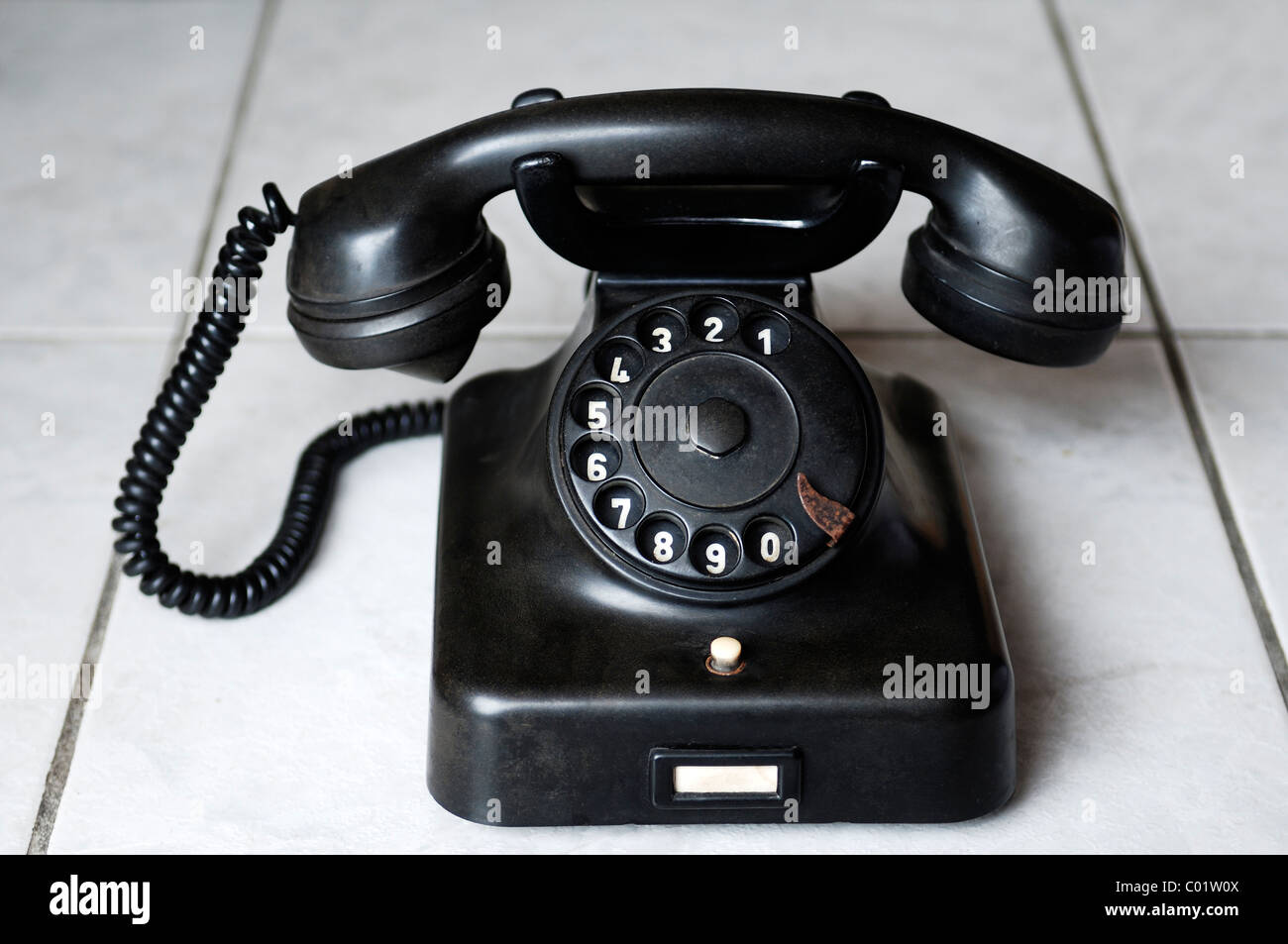Old bakelite phone from 1940 - 1950 - Stock Image