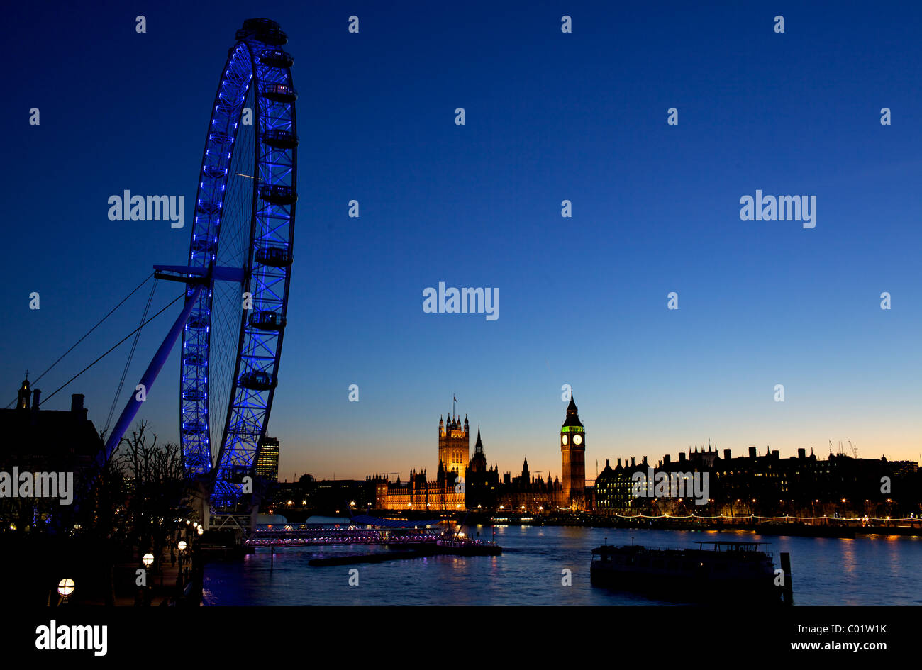 London eye and the houses of parliament at twilight - Stock Image