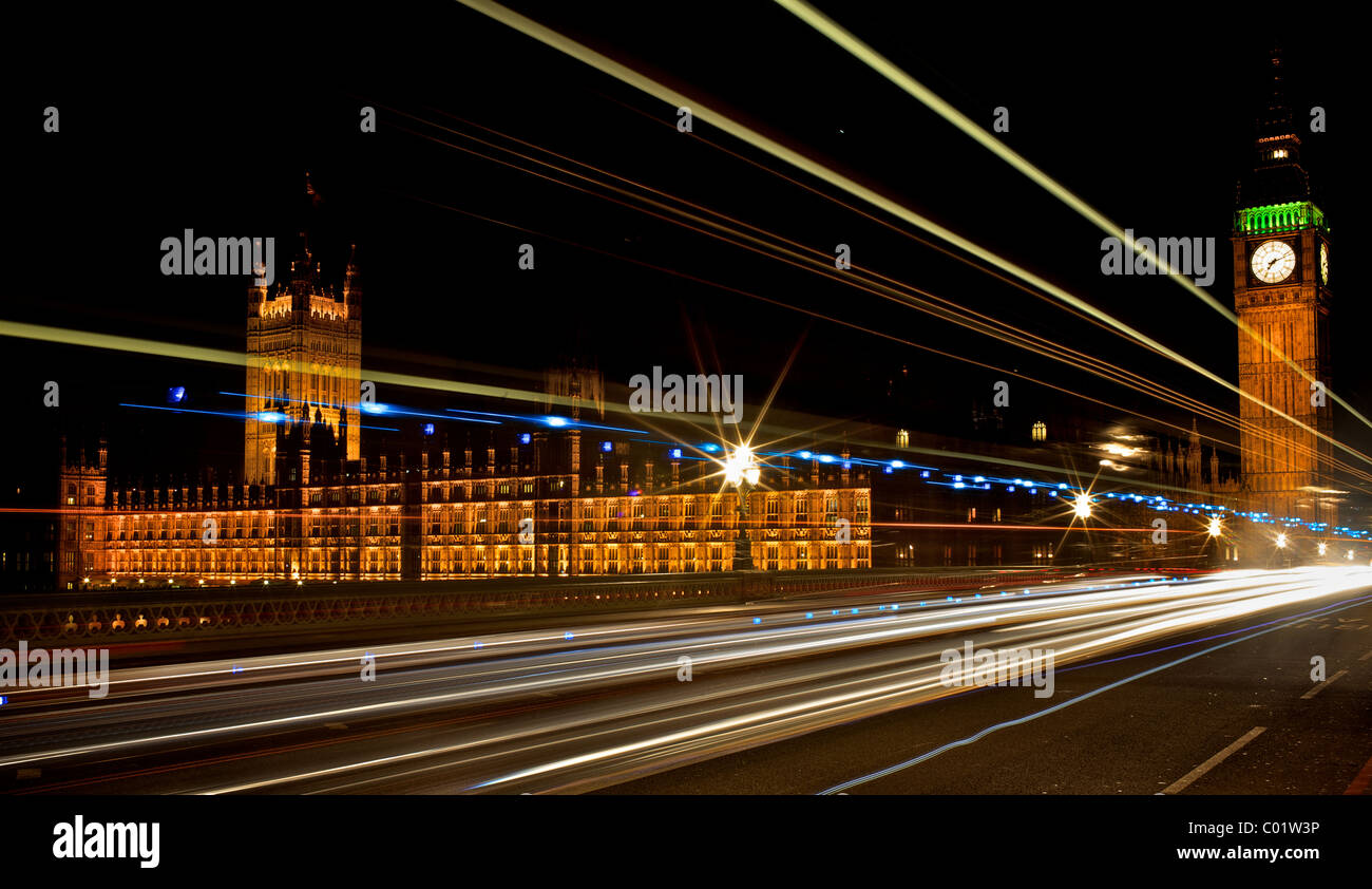 Light trails outside the houses of parliament in London - Stock Image