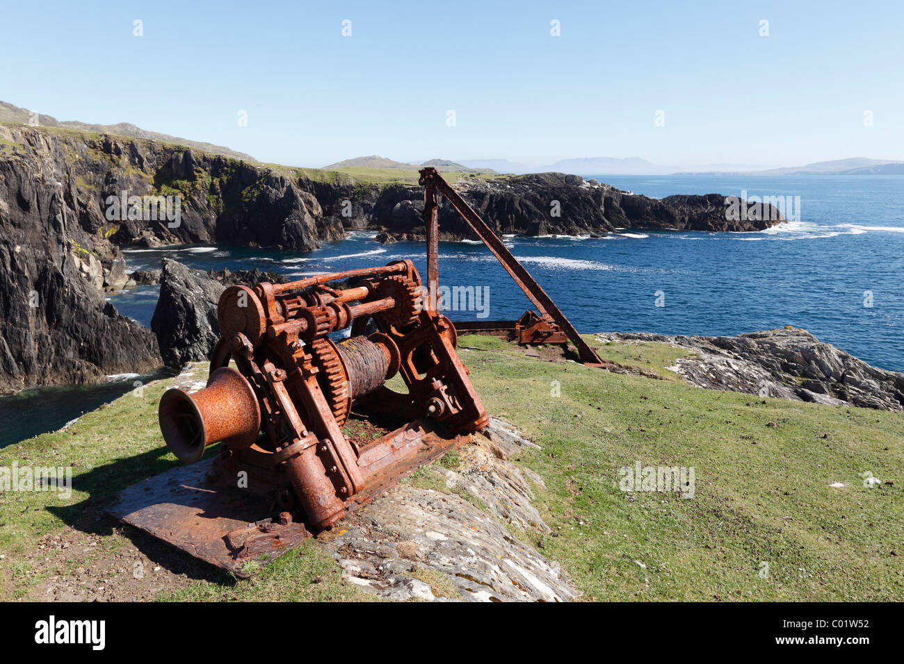 Cable winch, rocky coast in the south of Achill Island, County Mayo, Connacht province, Republic of Ireland, Europe - Stock Image