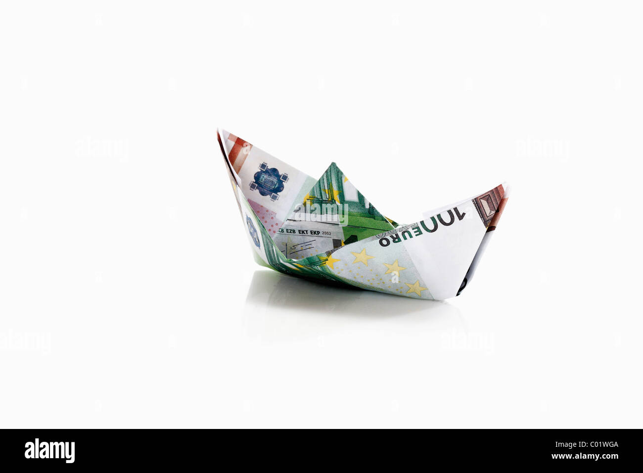 Paper boat from euro notes Stock Photo