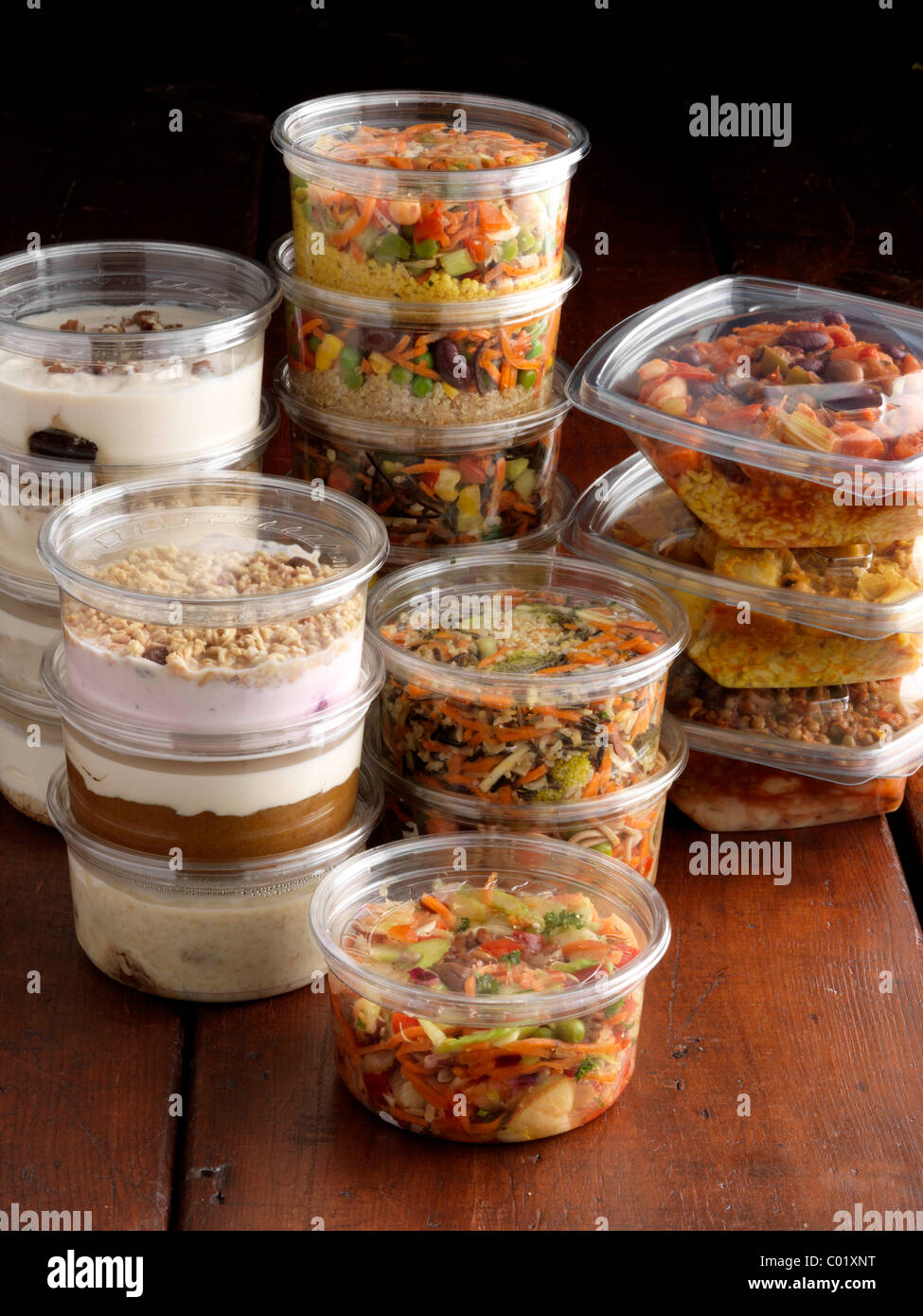 Vegetarian salads and desserts in plastic pots for takeaway - Stock Image