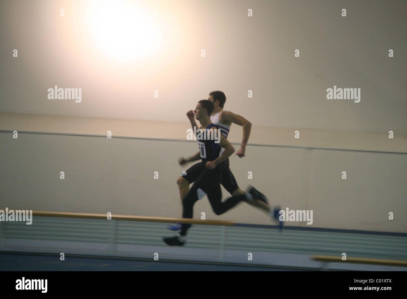 Sprinters, 10000 Metre Relay, Lee Valley Athletics Track, London Indoor Games, - Stock Image