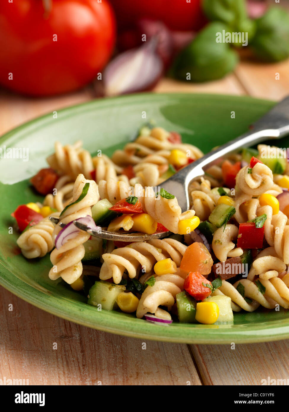 Individual portion of vegetarian spelt pasta salad - Stock Image