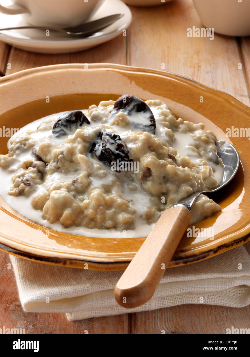 Individual portion of porridge and fruit vegetarian breakfast - Stock Image