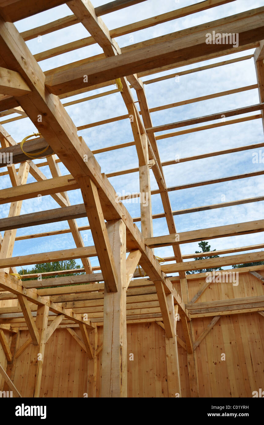 wood frame of house being built under construction - Stock Image