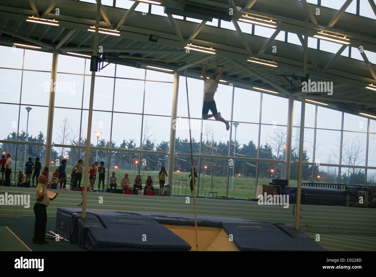 Athlete  doing the High Jump at Lee Valley  Athletics Track, in Enfield, London. - Stock Image