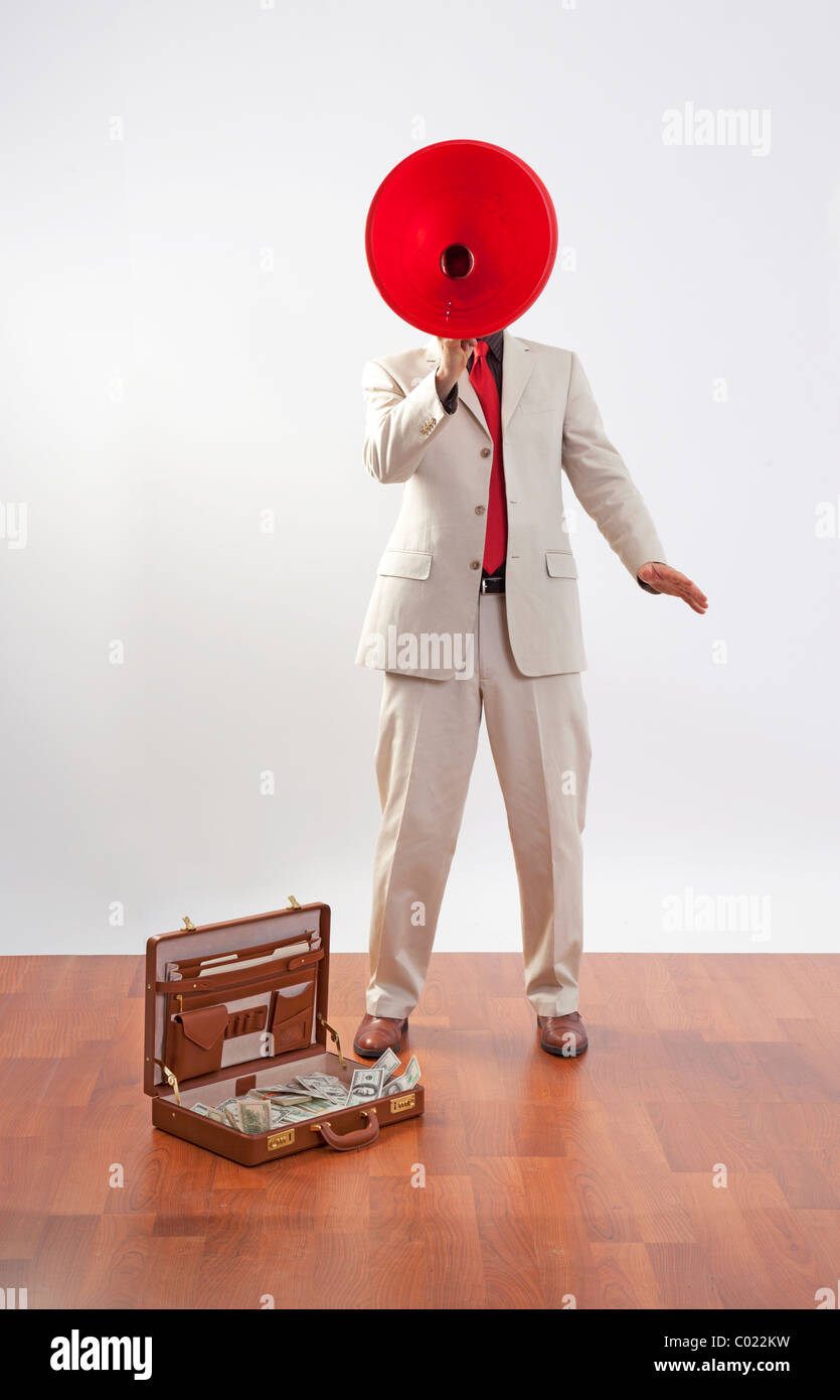 business man with red megaphone announces briefcase full of money in US dollars - Stock Image