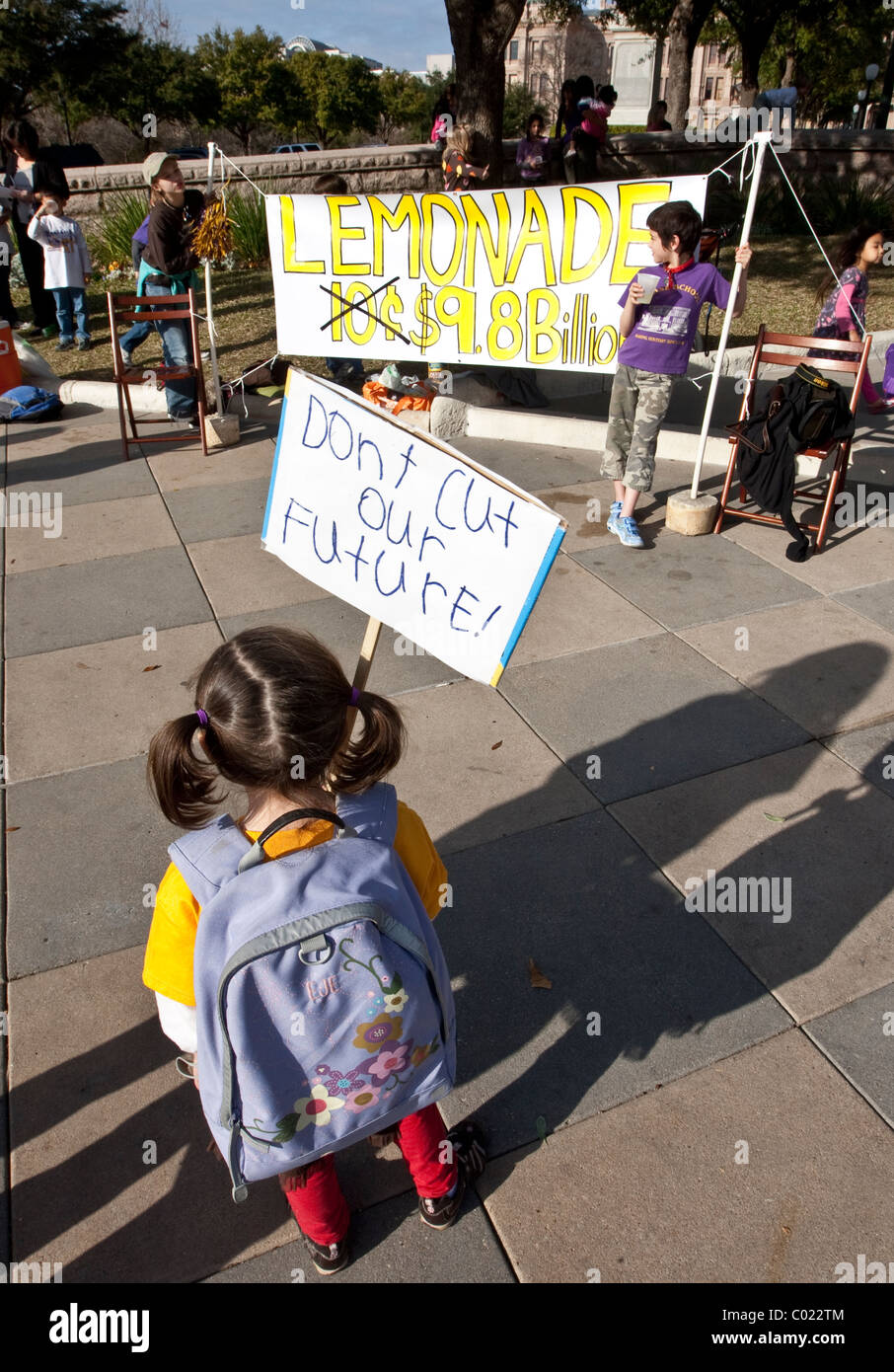 Elementary school aged girl holds sign during protest against education funding  and budget cuts in Texas - Stock Image