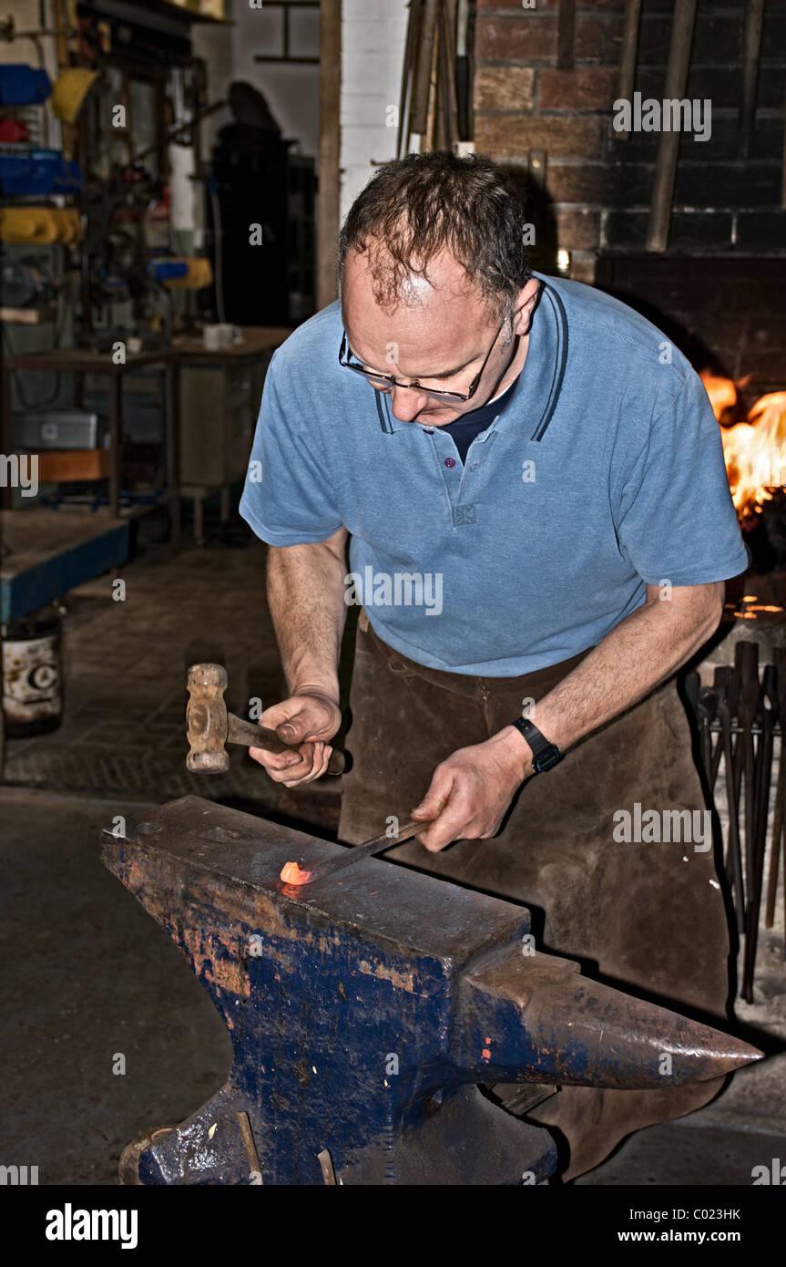Blacksmith at work - Stock Image