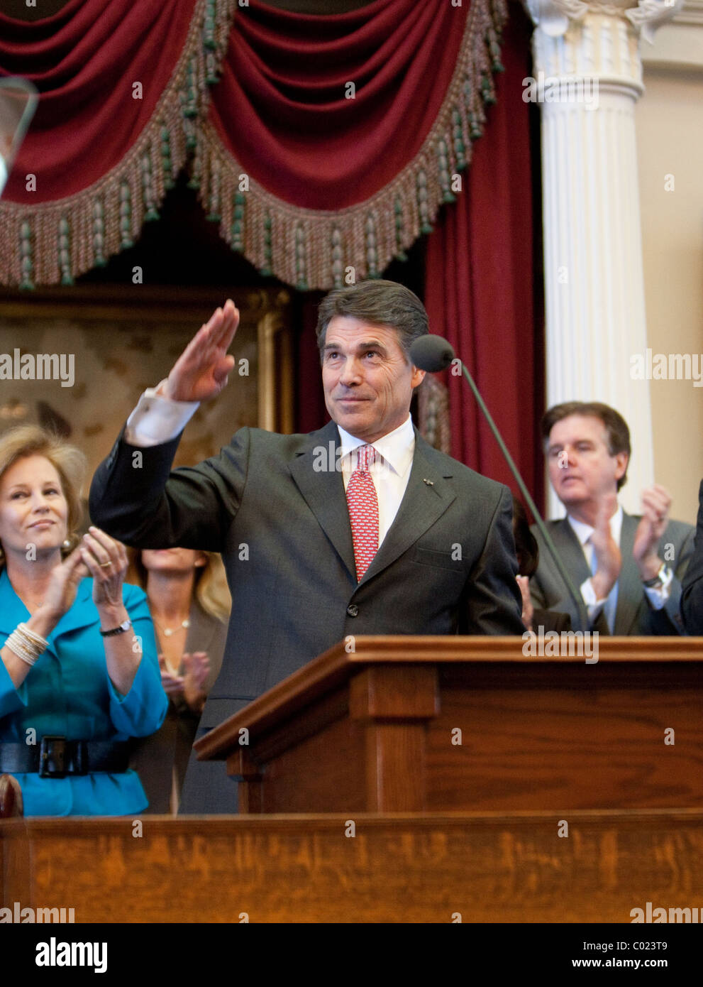 Texas Gov. Rick Perry acknowledges the audience before giving his bi-annual State of the State speech in the Capitol. - Stock Image
