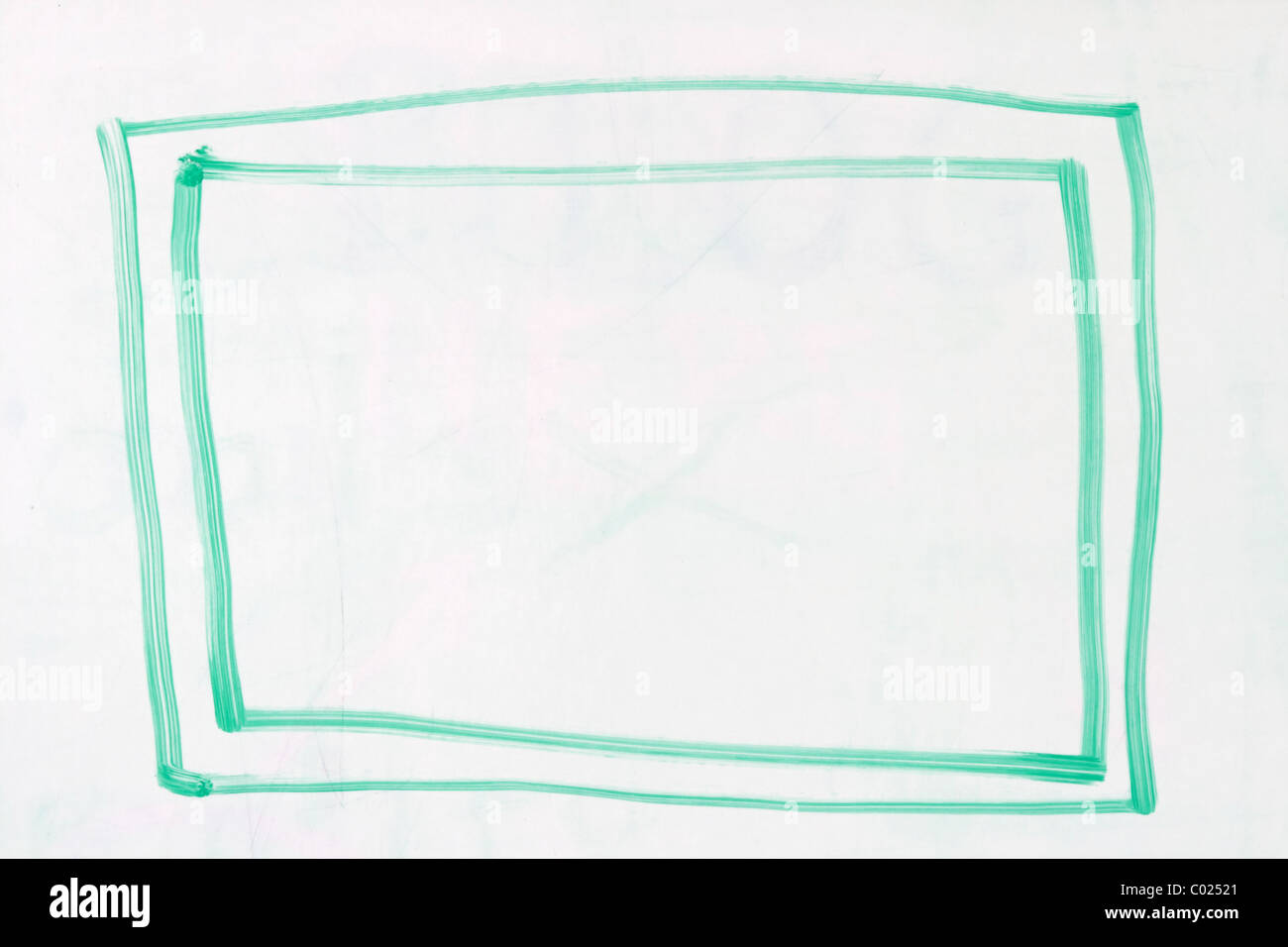 box with double outline in green dry erase marker on a used white board - Stock Image