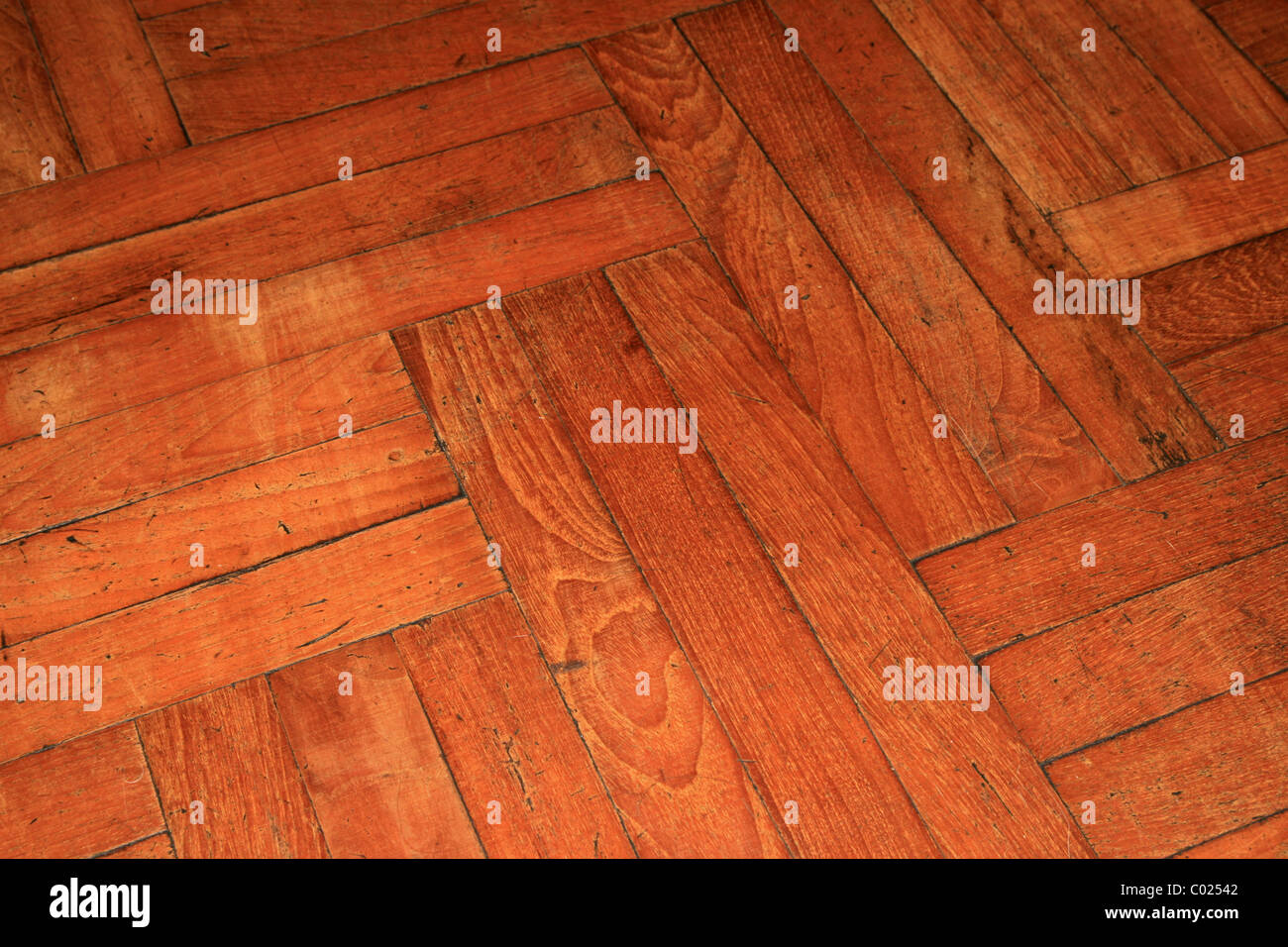 angled view of an old parquet wood floor - Stock Image