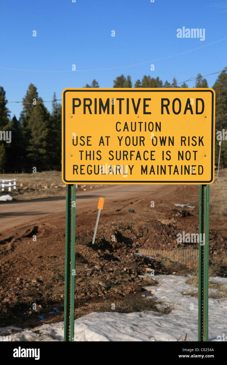 vertical image of caution primitive road sign - Stock Image