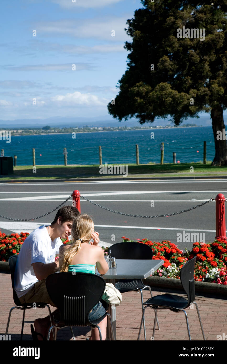The neatly manicured and visitor friendly town of Taupo nestles on the shores of volcanically formed Lake Taupo, - Stock Image