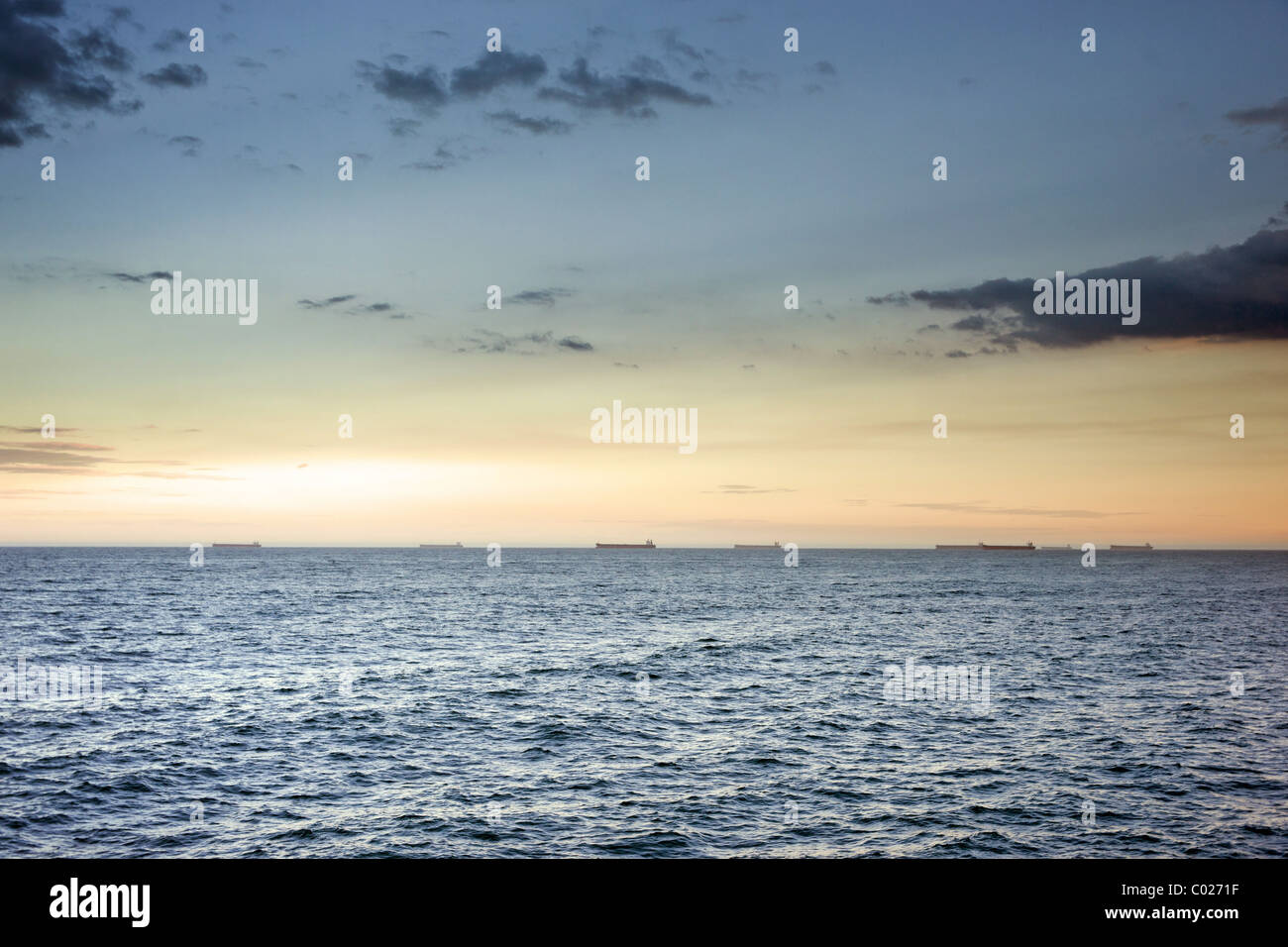 beautiful ocean waves at sunset newcastle australia Stock Photo