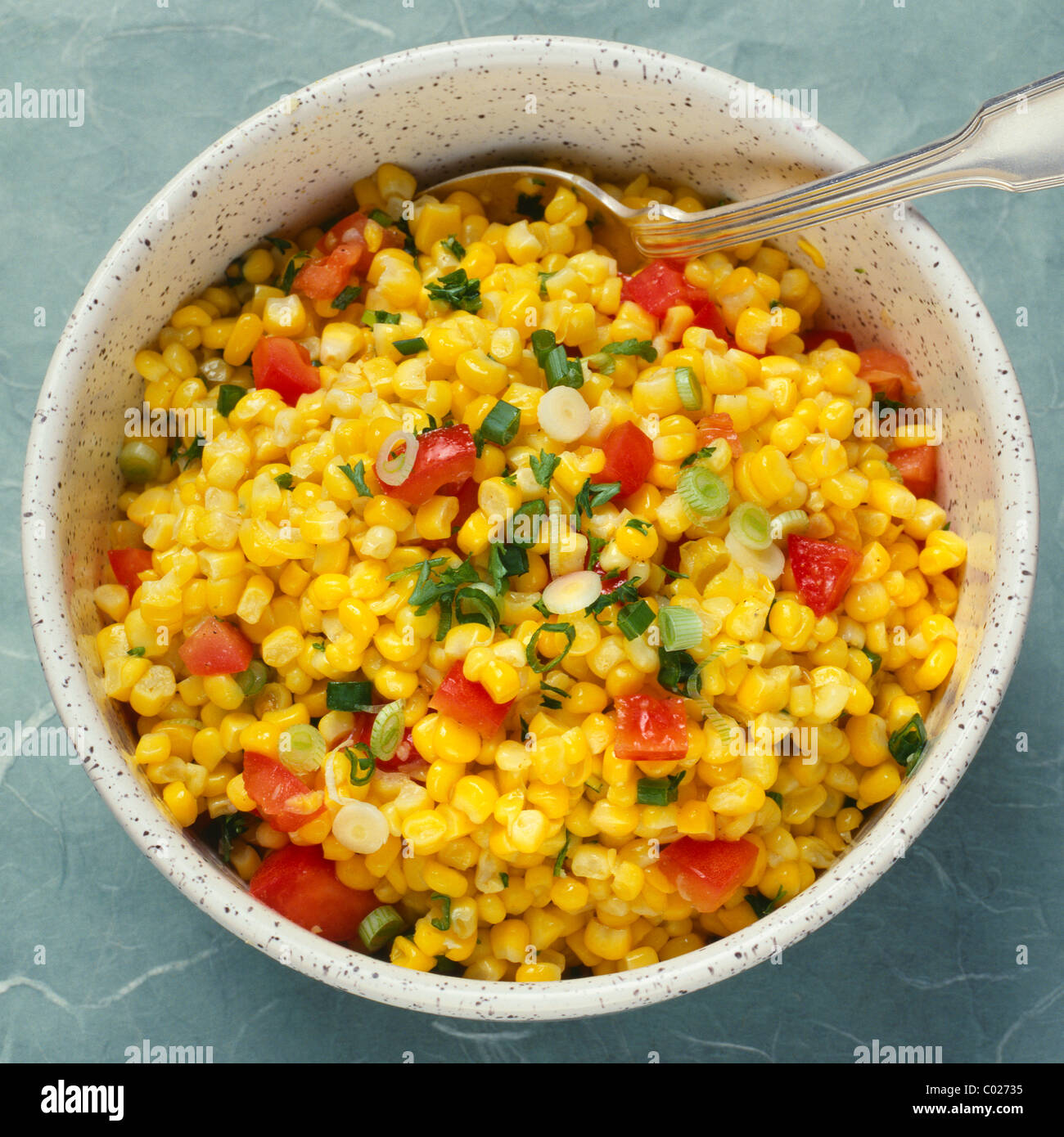 corn relish in bowl with spoon - Stock Image