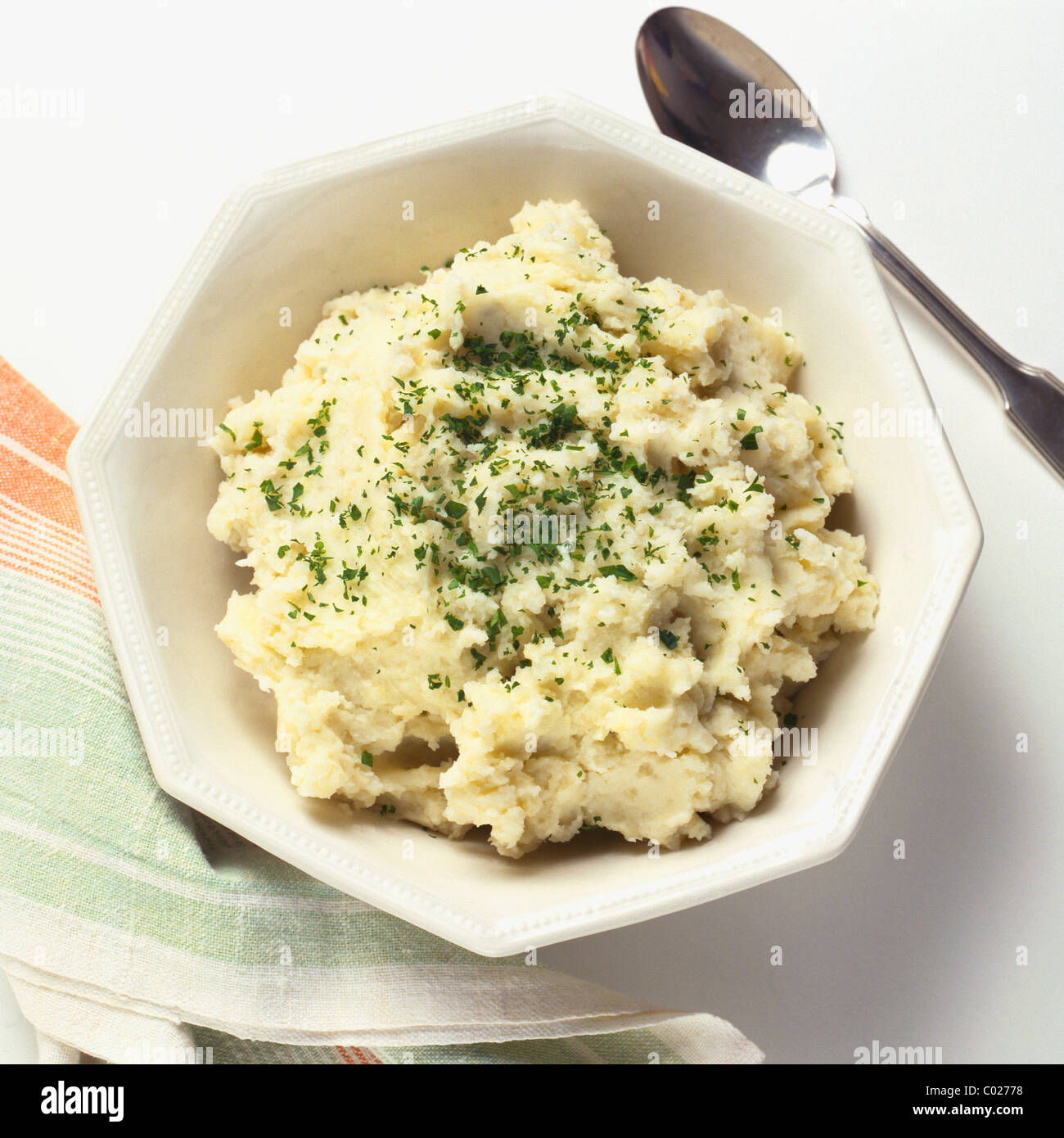 bowl of mashed potatoes with parsley - Stock Image