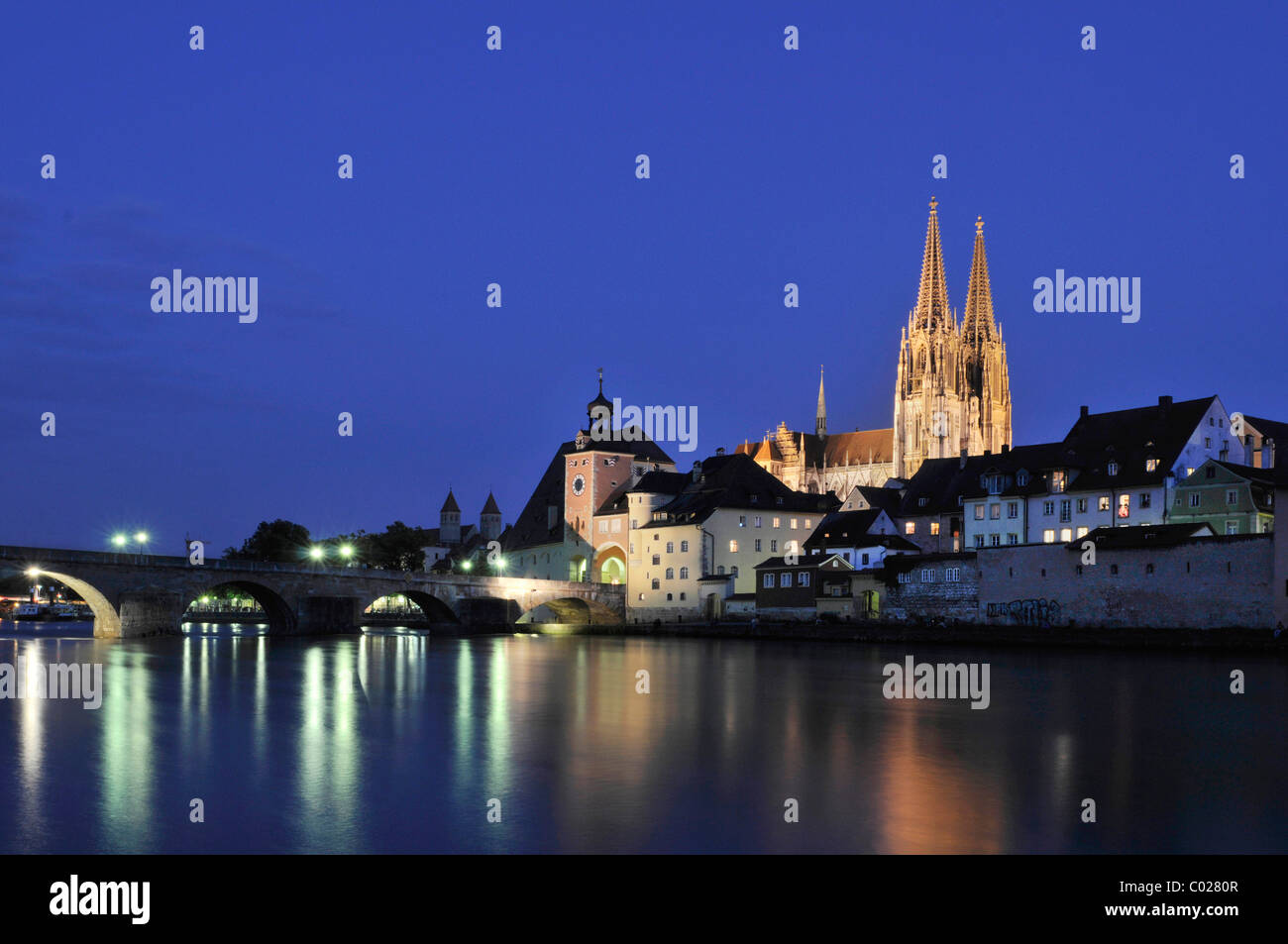 View over the Danube the Steinere Bruecke bridge, bridge gate, Regensburg Cathedral of St. Peter, old town - Stock Image