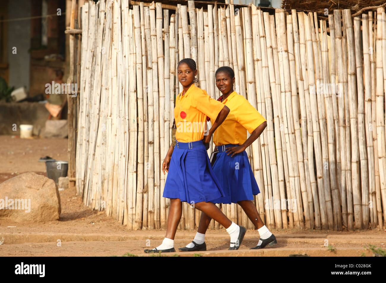 Teenage girls in school uniforms walk back home from school in Makeni, Sierra Leone, on Tuesday February 24, 2009. - Stock Image