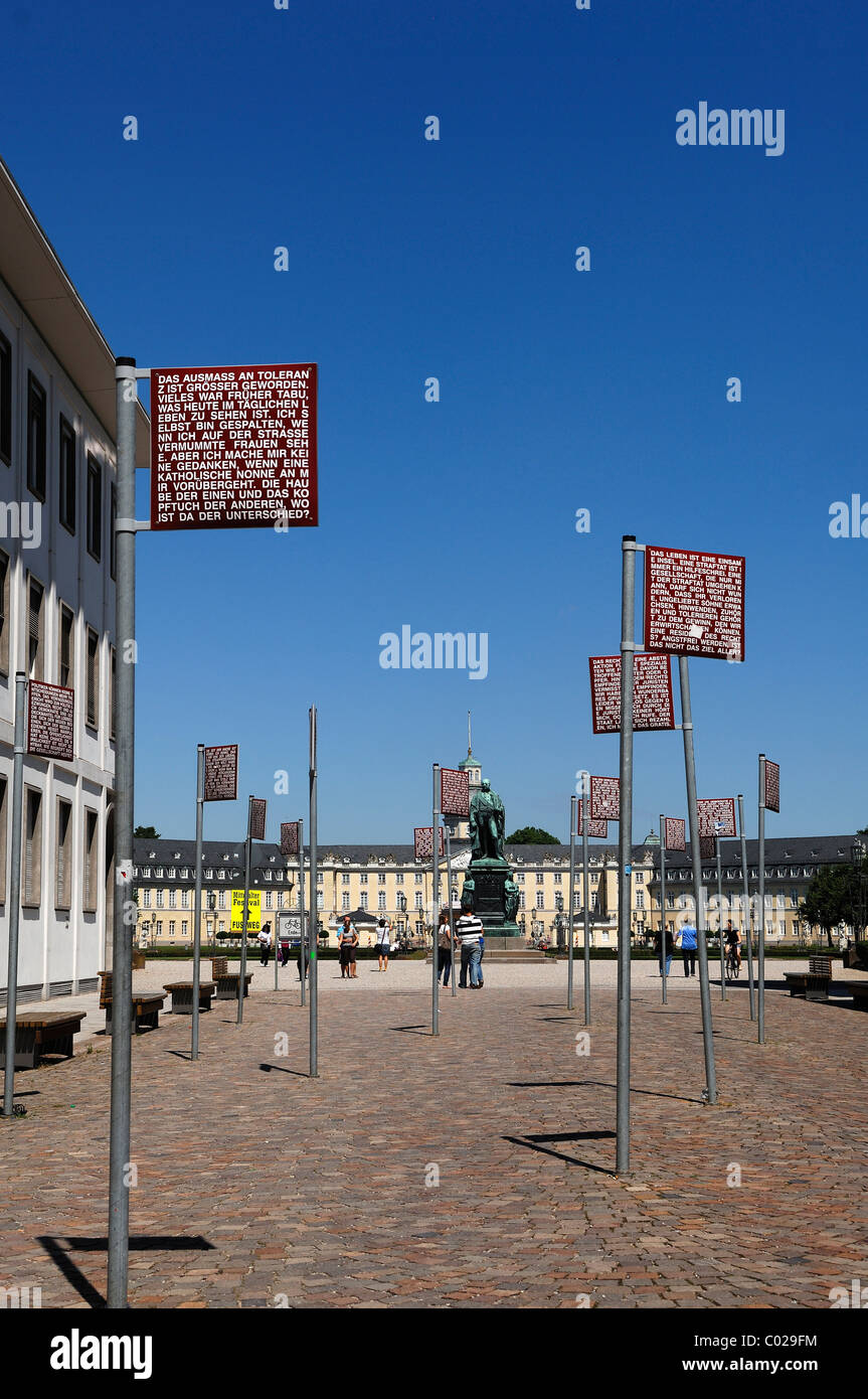 Signs with the basic rights on the Platz der Grundrechte or square of basic rights, in the rear the Schoss Karlsruhe - Stock Image