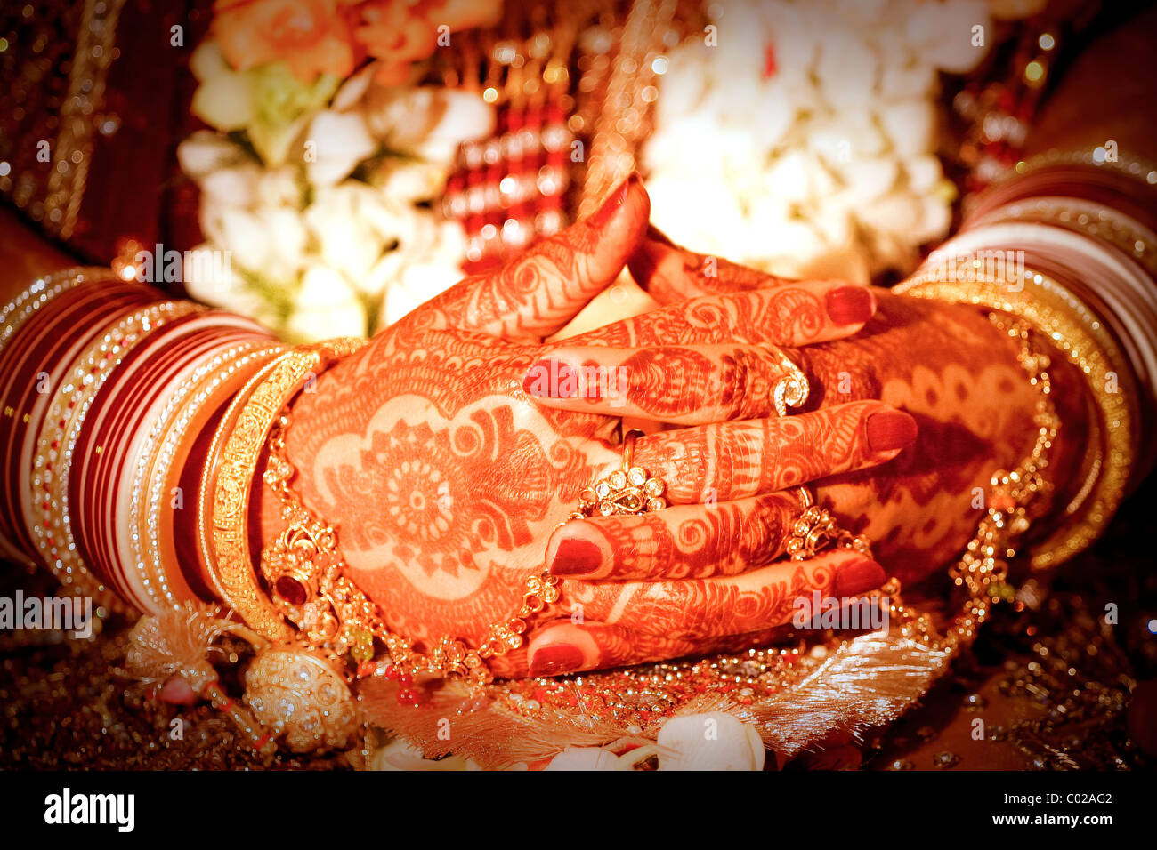 An Indian bride with her hands painted with henna. - Stock Image
