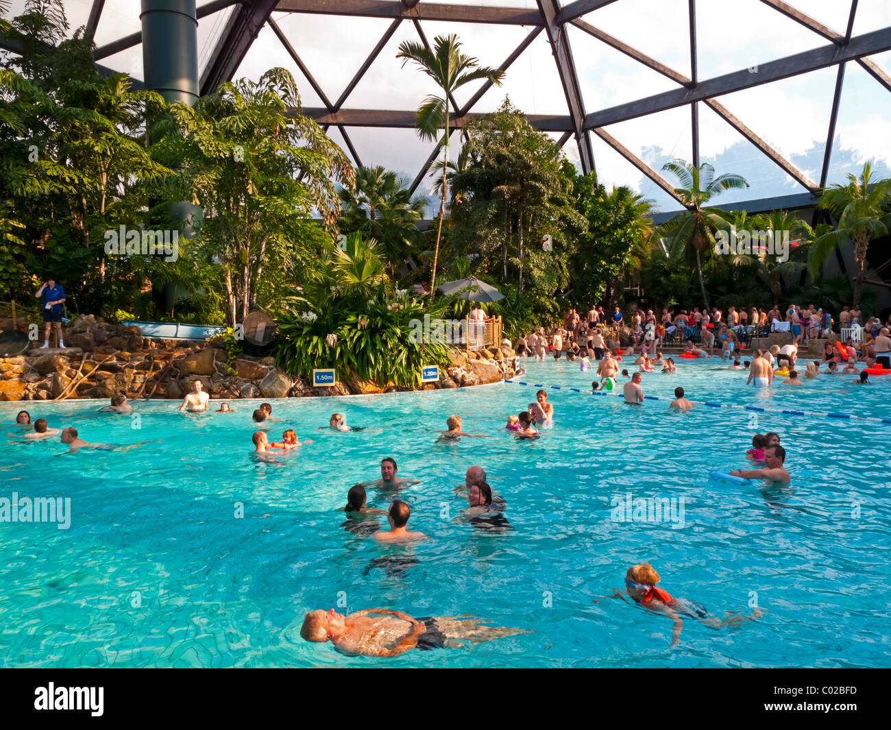 People swimming in the large domed pool at center parcs - Elveden forest centre parcs swimming pool ...