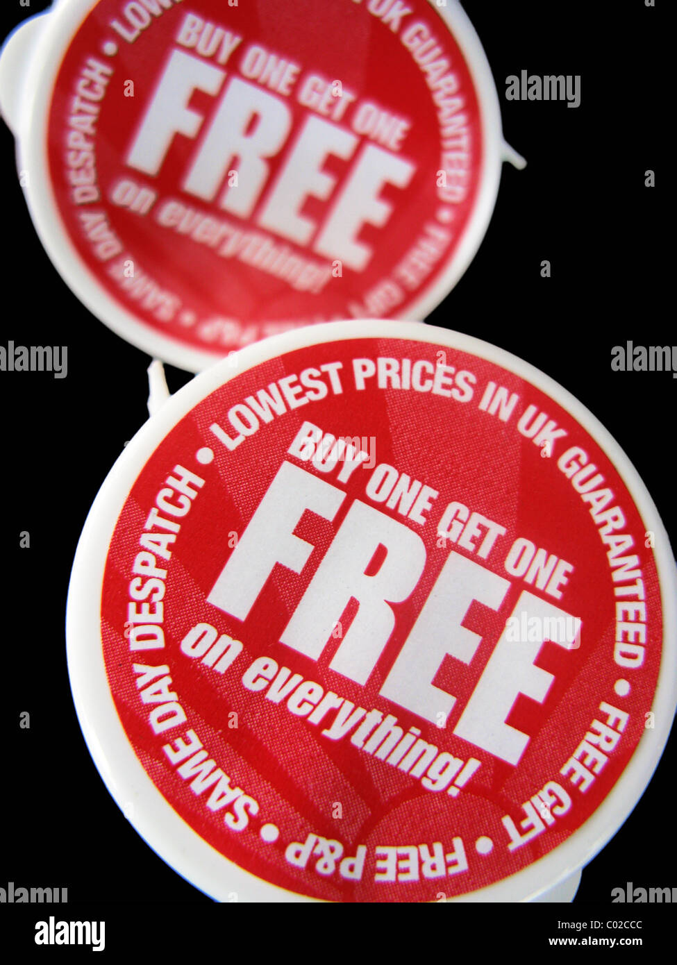 buy 1 get 1 free bargain on goods in a store Stock Photo: 34474396