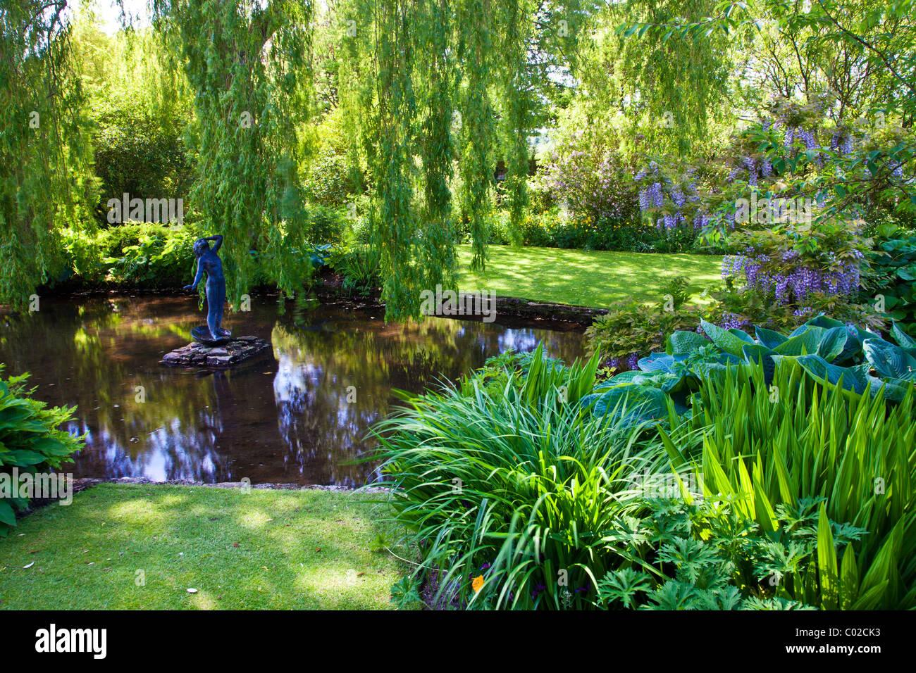 An Ornamental Garden Pond In An English Country Garden