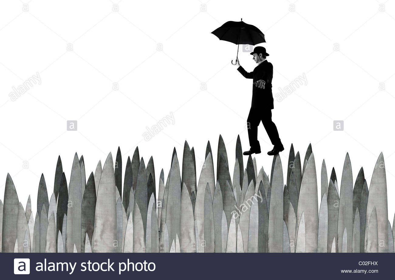 Banker Walking across knives - Stock Image