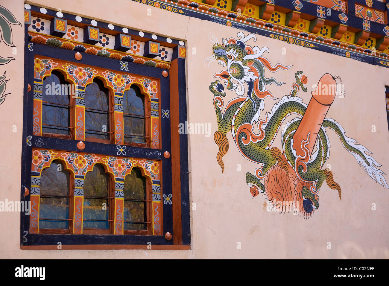Wall painting on a facade phallic symbol on the door to prevent evil spirits and symbolize fertility Thimphu Bhutan & Wall painting on a facade phallic symbol on the door to prevent ...