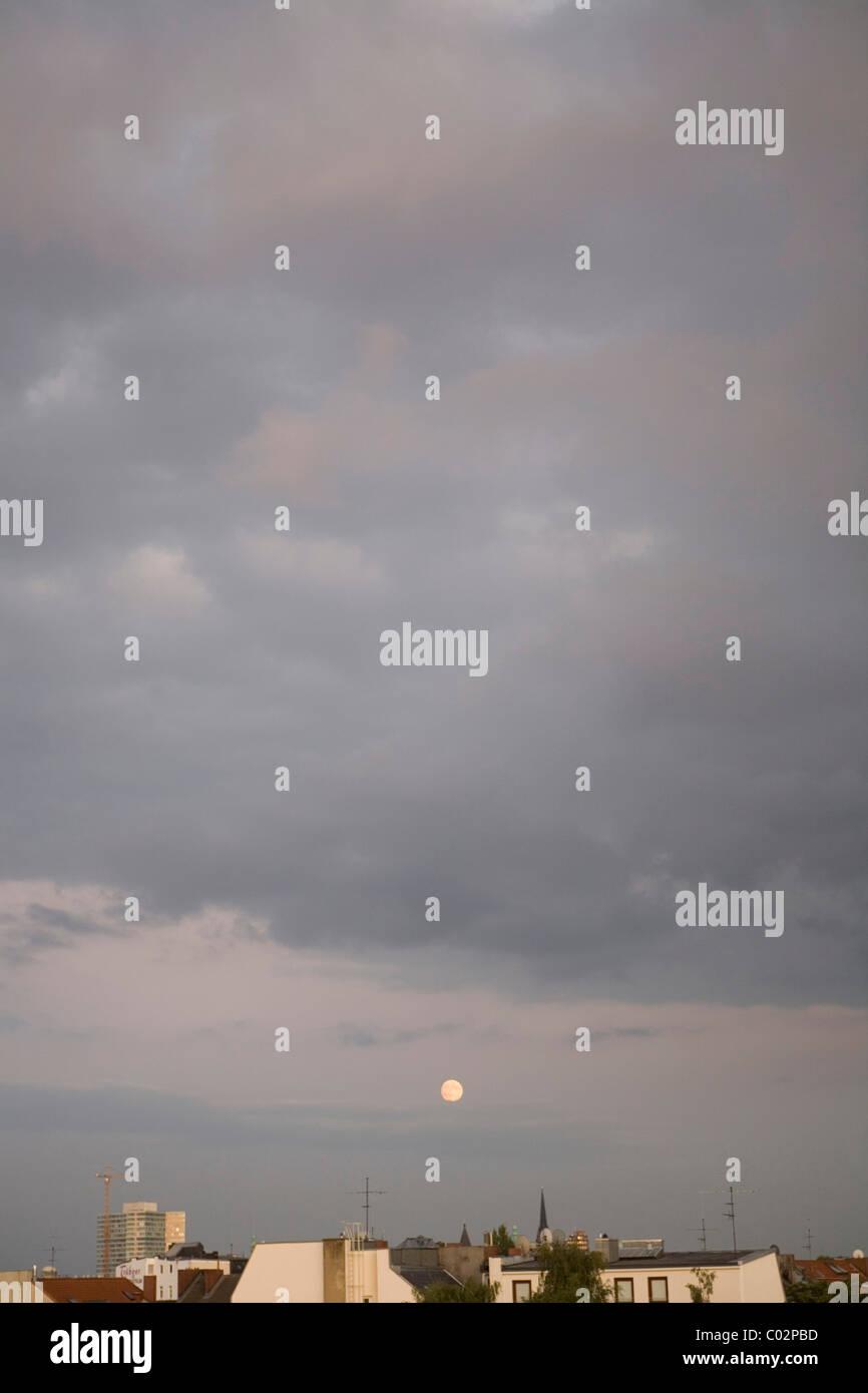 Moon over the rooftops of Hamburg, Germany, Europe - Stock Image