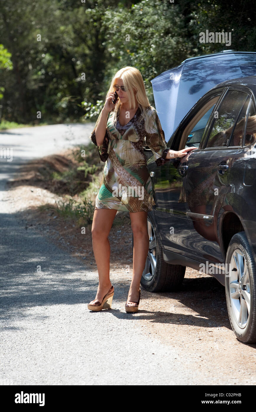 woman on the phone with the car broke down - Stock Image
