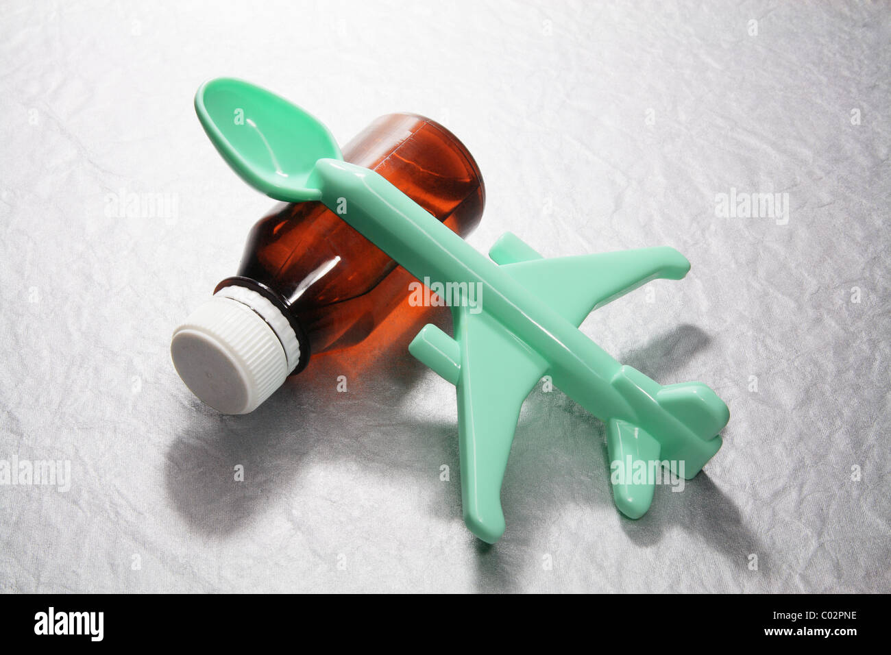 Cough Syrup and Measuring Spoon - Stock Image