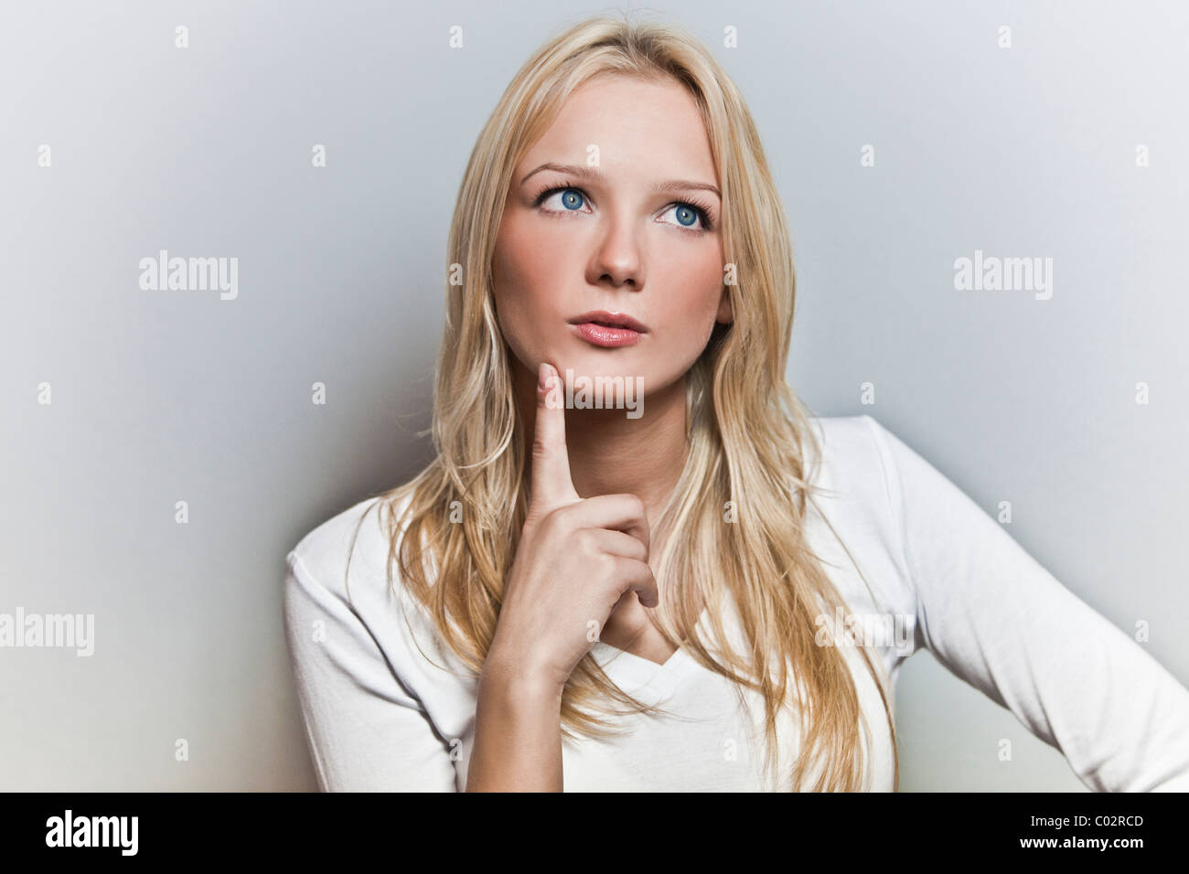 woman, questioning glance - Stock Image